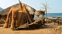 Traditional african hut at beach and building supplies