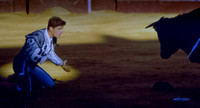 Bullfight matador kneeling med.
